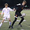 Plattsburgh High's Andrew Follmer (3) gains possession of the ball from Northeastern Clinton's Reid LaValley (12) during a boys Northern Soccer League Division I game Monday in Plattsburgh. Buy this photo and other images from area sporting events at pressrepublicanphotos.com.<br /> KAYLA BREEN/ STAFF PHOTO