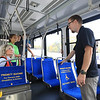 Nova Bus Industrial Engineering Technician Derek Bradt (right) explains the differences in seating on commuter and coach buses to visitors from Moriah Central School during North Country Manufacturing Day at Clinton Community College's Institute for Advanced Manufacturing. More than 300 high school students from Tupper Lake, Moriah, Westport, Chateaugay, Beekmantown, Adirondack P-Tech and CV-TEC participated in the annual event, along with local manufacturers Nova Bus, Norsk Titanium, Plattco, DOORspec, Mold-Rite and Bombardier. Students were invited to tour the IAM building while interacting with employers and asking questions about the manufacturing industry. The event was sponsored by ETS, Rulfs Orchard, the Institute for Advanced Manufacturing at Clinton Community College, Sam's Club and the Workforce Development Institute.<br /> KAYLA BREEN/ STAFF PHOTO