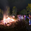 The flames from the 2018 SUNY Plattsburgh homecoming bonfire die down, leaving behind hot embers and ash from burned pallets as a handful of students, left over from hundreds, linger behind Memorial Hall on campus Friday afternoon. The weekend featured alumni games, campus tours, ice skating, planetarium shows, a welcome back social at the Monopole and much more.<br /> GABE DICKENS/ P-R PHOTO