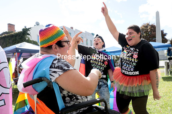 Amber Desjardins (from left), Brandi Meseck and her fiance, Keisha McCray, dance together in Trinity Park during the third-annual Adirondack North Country LBGTQ Pride event, hosted by the Adirondack North Country Gender Alliance, Saturday afternoon in Plattsburgh. Along with the parade through downtown Plattsburgh, the event also featured informational booths, live music by Joe Ferris, a drag show, and speeches by Assemblyman Billy Jones, Mayor Colin Read, Ron Zacchi from the New York Governor's Office, SUNY Plattsburgh student Gwendolyn Thomas and keynote speaker Juli Grey-Owens, a New York Transgender Community Advocate. Pride's goal is to bring together members of the LBGTQI+ community, family, friends and allies in a showing of solidarity and to promote love, acceptance, respect and unity.<br /> GABE DICKENS/ P-R photo