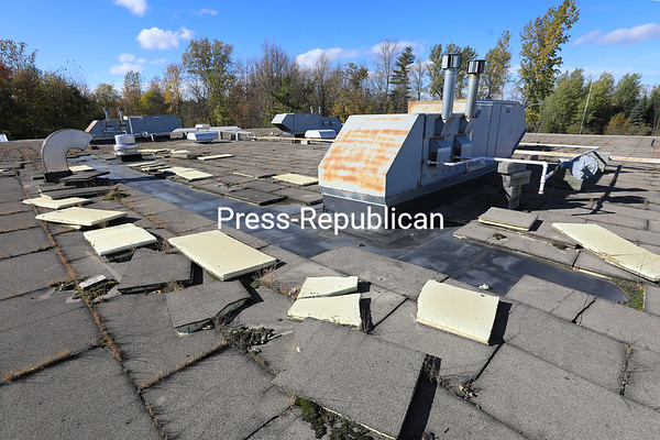 A heavily rusted HVAC roof-top unit sits among windswept tiles on the roof of the extensively deteriorated Champlain Valley Education Service's main building at 1585 Military Turnpike in Plattsburgh. A proposed $29.85 million capital project for CVES would fund infrastructure improvements, including a new roof and HVAC units, as well as traffic and safety enhancements. Voters will weigh in at a public referendum that will include CVES's 17 component school districts in Clinton, Essex, Warren and Washington counties on Tuesday, Dec. 11. KAYLA BREEN/ Staff photo