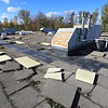 A heavily rusted HVAC roof-top unit sits among windswept tiles on the roof of the extensively deteriorated Champlain Valley Education Service's main building at 1585 Military Turnpike in Plattsburgh. A proposed $29.85 million capital project for CVES would fund infrastructure improvements, including a new roof and HVAC units, as well as traffic and safety enhancements. Voters will weigh in at a public referendum that will include CVES's 17 component school districts in Clinton, Essex, Warren and Washington counties on Tuesday, Dec. 11.<br /> KAYLA BREEN/ Staff photo