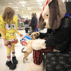 Dressed as Nickelodeon characters Spongebob Squarepants and Gary the Snail, 6-year-old Zoey Theisen and her 6-month-old beagle mix, Lulu, visit with mascot Chance the dog during the recent PetSmart Halloween Spooktacular event in Plattsburgh. Pets and their parents dressed in their Halloween best to participate in a costume parade, trick-or-treating and other holiday-themed events.<br /> KAYLA BREEN/ Staff photo