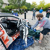 SUNY Plattsburgh sophomore Lucas Draffen, a human development and family relations major, takes a sledgehammer to the door hinges of a scrapped vehicle, donated by Lyman's Salvage, during the annual Tau Kappa Epsilon Car Smash, which raised more than $300 for St. Jude Children's Research Hospital Thursday afternoon in Amitie Plaza. Passers-by could buy two swings at the car for $1 or two minutes for $5 using a variety of objects including a steel pipe, crowbar and ax.<br /> GABE DICKENS/ P-R photo