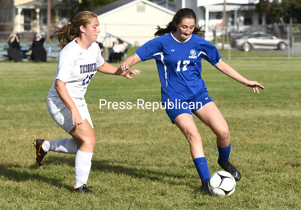Seton Catholic's Gillian Boule, right, beats Ticonderoga's Vivian Porter to a loose ball during a girls Northern Soccer League Division II game Tuesday in Plattsburgh. Buy this photo and other images from area sporting events at pressrepublicanphotos.com. JOEY LAFRANCA/ STAFF PHOTO