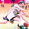 Saranac's Kayla Napper (left) tangles with a Northeastern Clinton opponent for possession of a loose ball during Tuesday's Northern Basketball League girls' matchup at Saranac Central School.<br><br>(GABE DICKENS/P-R PHOTO)