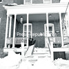 Heavy ice and snow from the last several weeks weakened the porch roofs at several houses on U.S. Oval in Plattsburgh, causing them to collapse. Tom Gosrich, one of the homeowners, said he is looking at insurance options, as far as getting repairs done. He said snow buildup was normal on the porches, but the ice was like a missile coming off the roof, creating a real disaster. No injuries have been reported. Gosrich did say one neighbor's car was damaged from falling ice.<br><br>(ROB FOUNTAIN/STAFF PHOTO)