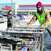 """With the temperature at zero, Dan Cassidy retrieves shopping carts Tuesday at Price Chopper in Plattsburgh. """"It's not that bad,"""" said Cassidy of the outdoor work, """"(but) if the wind picks up it could get tough."""" Daytime temperatures are expected to be in single digits until the weekend, when slightly warmer weather is expected.<br><br>(ROB FOUNTAIN/STAFF PHOTO)"""