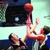 Westport's Ryan Davis shoots over Crown Point's Joe Foote during Friday's boys' Northern Basketball League crossover game in Westport.<br><br>(Alvin Reiner/P-R Photo)