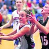 Westport's Brendee Russell slaps the ball away from Crown Point's Logan Harrington during Friday's girls' Northern Basketball League crossover game in Westport.<br><br>(Alvin Reiner/P-R Photo)