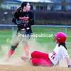 Plattsburgh's Lauren Stanley (left) looks to first base after getting the force-out on Saranac's Sydney Adolfo during Tuesday's CVAC softball game at South Acres Park in Plattsburgh.<br><br>(GABE DICKENS/P-R PHOTO)
