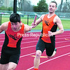 Plattsburgh's Ryan Durocher (right) prepares to hand off the baton to Skylar Barriere during the boy's 400-meter relay during Tuesday's Champlain Valley Athletic Conference outdoor track and field meet with Northeastern Clinton at Plattsburgh High School.<br><br>(GABE DICKENS/P-R PHOTO)