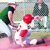 Schroon Lake's Justin Lough slides in safely at home as Elizabethtown-Lewis' Austin Morris attempts to apply the tag during Monday's Mountain and Valley Athletic Conference baseball game.<br><br>(ALVIN REINER/P-R PHOTO)