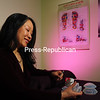 """Dr. Karen Kan prepares for an acupuncture session. The Lake Placid doctor recently authored """"Guide to Healing Chronic Pain -- a Holistic Approach.""""<br><br>(JACK LADUKE/P-R PHOTO)"""