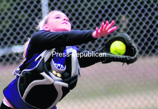 Ticonderoga catcher Carly Campney makes a diving catch during Tuesday's Champlain Valley Athletic Conference softball game against AuSable Valley in Clintonville. The Sentinels outlasted the Patriots, 10-9.<br><br>(ROB FOUNTAIN/STAFF PHOTO)