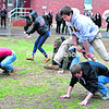 SUNY Plattsburgh student Michael Marvin, a member of the Phi Kappa Phi fraternity, jumps over a teammate during the leapfrog race at the Greek Week Olympics event held Saturday. Marvin's team won. Other activities on the rainy day included an egg-balancing race, water balloon toss and relay race.<br><br>(BEN ROWE/P-R PHOTOS)