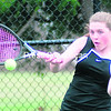 Plattsburgh's Kelsey Senecal returns a serve from Seton Catholic's Kelli Ryan during Monday's Champlain Valley Athletic Conference girls' tennis match in Plattsburgh. Senecal defeated Ryan, 6-4, 6-3.<br><br>(ROB FOUNTAIN/STAFF PHOTO)