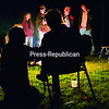 People gravitate toward one of two bonfires on the New Land Trust property to stay warm on an unusually cool Adirondack evening last weekend.<br><br>(GABE DICKENS/P-R PHOTO)