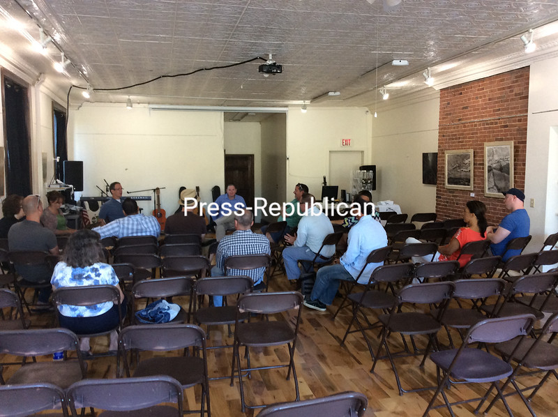 Members of the Plattsburgh Downtown Association meet recently. The group would like recognition as the one voice for the interests of downtown businesses.