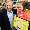 Momot Elementary School student Olivia Gottschall, with Plattsburgh City Mayor James Calnon at a news conference at Plattsburgh City Hall on Thursday, shows off the artwork that won the Battle of Plattsburgh Poster Contest this year. Her drawing will be displayed on 5,000 admission buttons for the festivities marking the 200th anniversary of the pivotal conflict. The Bicentennial Battle of Plattsburgh Commemoration runs Aug. 29 through Sept. 14.<br><br>(ROB FOUNTAIN/STAFF PHOTO)