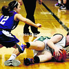 Elizabethtown-Lewis' Tamara Wescott dives for a loose ball as Ticonderoga's Savannah Bezon defends during the championship game of the Alzheimer's Awareness Basketball Tournament Wednesday. The Sentinels won, 49-30.<br><br>(ALVIN REINER/P-R PHOTO)
