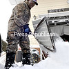With light snow falling, Shedrick Jenkins clears his driveway on Cogan Avenue in the City of Plattsburgh on Thursday after Winter Storm Vulcan dumped foot of snow on much of the North Country. Most of the region received 8 to 12 inches of snow and up to 2 feet in the higher elevations.<br><br>(ROB FOUNTAIN/STAFF PHOTO)
