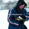 Postal carrier Cory Hanf braves the cold and driving snow from with Winter Storm Vulcan while delivering mail along his route on Oak Street in the City of Plattsburgh on Wednesday.<br><br>(GABE DICKENS/P-R PHOTO)
