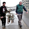 """Mark Bondi (left) and Michael Hart carry Bondi's untitled steel sculpture to Hart's truck on the SUNY Plattsburgh campus on Tuesday. The sculpture will be part of """"Migrating Passerines,"""" an annual exhibition of art student's works at the Pouring Light Studios and Gallery in Malone.<br><br>(ROB FOUNTAIN/STAFF PHOTO)"""