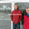 Associate Pastor Nick Beachy (left) and Pastor Edwin Attaway of the First Christian Church in Brushton braved the heavy snow and sharp winds Wednesday to promote a fundraiser at the Hope Community Center. The extended winter has drained the center's fuel budget, prompting the need to raise more money to keep the popular gathering place warm.<br><br>(Denise A. Raymo/Staff Photo)