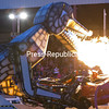 Megasaurus, which stands three-stories tall and has 15,000 pounds of both crushing and biting force, takes a moment to display its satisfaction in ripping apart a vehicle by unleashing over 200,000 BTUs of burning power during the Night of Fire and Destruction at the Clinton County Fairgrounds in Morrisonville. The recent show also included figure-eight car races, monster trucks and motorcycle daredevil Doug Danger.<br><br>(Gabe Dickens/P-R Photo)