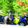 A state trooper walks past the Honda Fit struck head-on by a pickup truck that had been traveling at a high rate of speed westward on Route 86 in the Town of North Elba on Thursday afternoon. Killed in the crash were James E. and Kim Barney of Potsdam, who were traveling in the Honda with Mrs. Barney's 11-year-old daughter, Emily Colby. Emily suffered multiple injuries and was undergoing surgery at Fletcher Allen Health Care in Burlington on Thursday night.<br><br>(JACK LADUKE/P-R PHOTO)