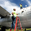 """Town of Plattsburgh Public Works employees Chris Bleaux (on the ground) and John Rodriguez wash down the B-47 aircraft on display outside the former Plattsburgh Air Force Base at Clyde Lewis Park. Next, they planned to buff and then paint the bomber and the FB-111 also parked there to improve their appearance. """"It's been a really long time since they had a good cleaning,"""" Bleaux said. """"It was time.""""<br><br>(ROB FOUNTAIN/STAFF PHOTO)"""