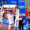 Kyle Buckingham celebrates at the finish after crossing the line first in the Ironman Lake Placid renewal. It was the first victory as a professional for the South African.<br><br>(JACK LADUKE/P-R PHOTO)