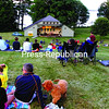 "North Country residents and visitors enjoy a performance by Samuel Torres and Manuel Valera at Ballard Park in Westport. Torres and Valera demonstrated their virtuosity on approximately 20 Latin American musical instruments at the recent concert. Upcoming concerts, all at 7:30 p.m., are: Meadowmount String Quartets, today; Joe Brent & Sara Caswe -- ""9 Horses,"" Aug. 7.; Michael Chorney's ""Hollar General,"" and ""Magic City: The Songs of Sun Ra,"" Aug. 14; Jason Lindner's ""Super Future Griots,"" Aug. 21; Rebecca Martin and Larry Grenadier, Aug. 28. For more information visit www.ballardparkny.org<br><br>(ALVIN REINER/P-R PHOTO)"