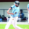 The Clinton County Senior Mariners' Jeremy Barber raps a hit during the second game of Saturday's American Legion District 4 playoffs at Chip Cummings Field in Plattsburgh Saturday afternoon.<br><br>(GABE DICKENS/P-R PHOTO)