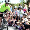 Bob Light, a University Police Officer at SUNY Plattsburgh and a member of its bicycle patrol, high-fives a line of children at Cumberland Head Elementary School in Plattsburgh Friday afternoon after paying a visit to the school where volunteers with Safe Kids Adirondack fitted 147 first- and second-graders with bicycle helmets. Light and a small contingent of cyclists started the morning at Northern Adirondack Elementary, and traveled to Mooers, Rouses Point and Chazy before concluding the tour at Cumberland Head. Overall, 488 children were given helmets and lessons on bike safety at the five schools (GABE DICKENS/P-R PHOTO).