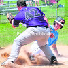 Clinton County Junior Mariners Alex Follmer (3) comes home on a passed ball with Montreal Rockies pitcher Guillaome Gravel (42) covering Sunday at Lefty Wilson Field. The Junior Mariners split in their season-opening doubleheader. (ROB FOUNTAIN/STAFF PHOTO)