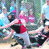 Schroon Lake's Julianna Finnerty (left) can't handle the throw home as Crown Point's Amanda Wolf slides in safely for the score during Saturday's Section VII Class D championship softball game at Cardinal Park in Plattsburgh.  Crown Point won 7-1. (GABE DICKENS/P-R PHOTO)