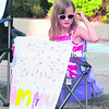 Hannah Perdziak of Saratoga shows her support for her mom, Stephanie, in the 5K race Sunday during the Biggest Loser RunWalk in Plattsburgh. (ROB FOUNTAIN/STAFF PHOTO)