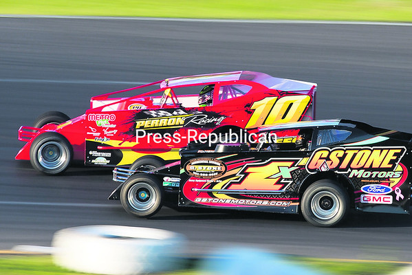 Todd Stone (right) of Middlebury, Vt., and Patrice McGrail of Candiac, Que. race neck-and-neck during the early stages of the Ernie's Tools DIRTcar 358-Modified feature event at Airborne Park Speedway in Plattsburgh Saturday evening. (GABE DICKENS/P-R PHOTO)