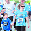 """Jodie Osborne and her son, Jordan, of Peru, take part in the 5K portion of Sunday's Biggest Loser RunWalk at City Hall in Plattsburgh. The event included a number of competitions, a concert and visits from former contestants of the NBC show """"Biggest Loser.""""  (ROB FOUNTAIN/STAFF PHOTO)"""