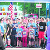 Dalton Kane (7145, center) stands at the starting line waiting to begin the 5K race portion of Sunday's Biggest Loser RunWalk at City Hall in Plattsburgh. The 9-year-old finished second overall with a time of 20:06. (ROB FOUNTAIN/STAFF PHOTO)