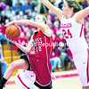 Saranac's Summer Gillespie (left) drives to the basket for a layup past the outstreched arms of Beekmantown's Shannon Ryan during Friday's Section VII Class B girls' basketball championship game at the Field House in Plattsburgh.<br><br>(GABE DICKENS/P-R PHOTO)
