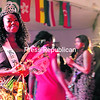 SUNY Plattsburgh student Erinola Araoye walks down the red carpet after being named pageant queen at the 2014 African Unity Malkia: Sand of Gold Pageant and Fashion Show. Araoye represented her home nation of Nigeria in the event. Competing against her were students Winnie Johnson, representing Liberia; Eluise Vaz, representing Mozambique; Souadou Camara, representing Guinea; and Emmanuella Alliali, representing Ivory Coast. The event also featured runway walks by models wearing African-inspired outfits designed by national and student fashion companies.<br><br>(BEN ROWE/P-R PHOTO)
