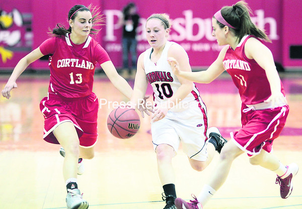 Plattsburgh State's Brittany Marshall (middle) finds an open lane between Cortland defenders Megan Touhey (left) and Shannon White during Friday's SUNYAC women's basketball semifinal victory at Memorial Hall in Plattsburgh.<br><br>(GABE DICKENS/P-R PHOTO)