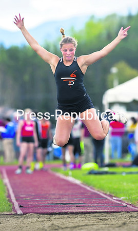 Plattsburgh's Kaylia Carper flies through the air in the long jump event at Saturday's Section VII Track and Field Championships in Lake Placid. Carper's jump of 16 feet, five inches captured her first place.<br><br>(CHRIS LENNEY/P-R PHOTO)