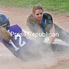 Ticonderoga's Maura Jebb (12) slips under the tag of Peru's catcher Brittany Miner Monday during CVAC Girls Softball action in Peru. <br><br>(ROB FOUNTAIN/STAFF PHOTO)