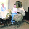 """Babies, Bonnets and Buggies,"" the theme for this year's open house at Franklin County Historical and Museum Society House of History in Malone, includes antique baby carriages, clothing, dolls, toys and more, which are part of the collection or on loan from community members. Volunteers Jean Goddard (left) and Claire Russell, plus many others, have been preparing for the open house, set for 1 to 4 p.m. June 7, 8 and 14. (SUSAN TOBIAS/P-R PHOTO)"