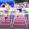 Ticonderoga's Jay Hebert (center) leads the way during the 110 hurdles at Saturday's Section VII Track and Field Championships in Lake Placid. Hebert retained his title with a time of 14.3.<br><br>(CHRIS LENNEY/P-R PHOTO)