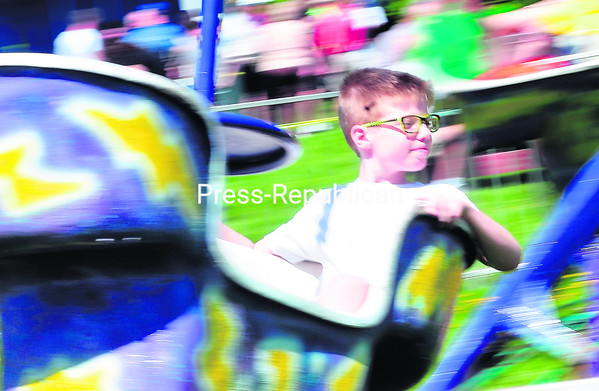 Odin Nelson is all smiles riding the Mind Winder Sunday during the St. Mary's Parish Bazaar and Parade in Champlain. The event included a chicken barbecue, games, rides and music.<br><br>(ROB FOUNTAIN/STAFF PHOTO)